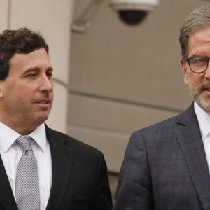 Former St. Louis County Executive Steve Stenger, left, and Stenger's lawyer, Scott Rosenblum, right, exit the Thomas F. Eagleton U.S. Courthouse Friday, May 3, after Stenger pleaded guilty to three counts of theft of honest services/bribery and mail fraud. A sentencing hearing will be held Aug. 9. Stenger faces to three to four years in federal prison. Photo by Erin Achenbach.