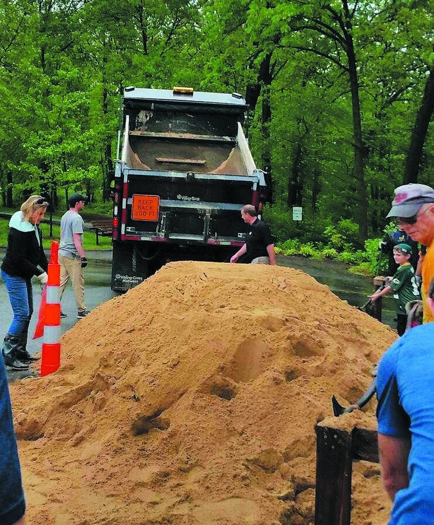 The city of Sunset Hills provided sandbags to residents impacted by flooding in 2017. Volunteers responded in force to the city's call to fill the sandbags at Watson Trail Park, above.