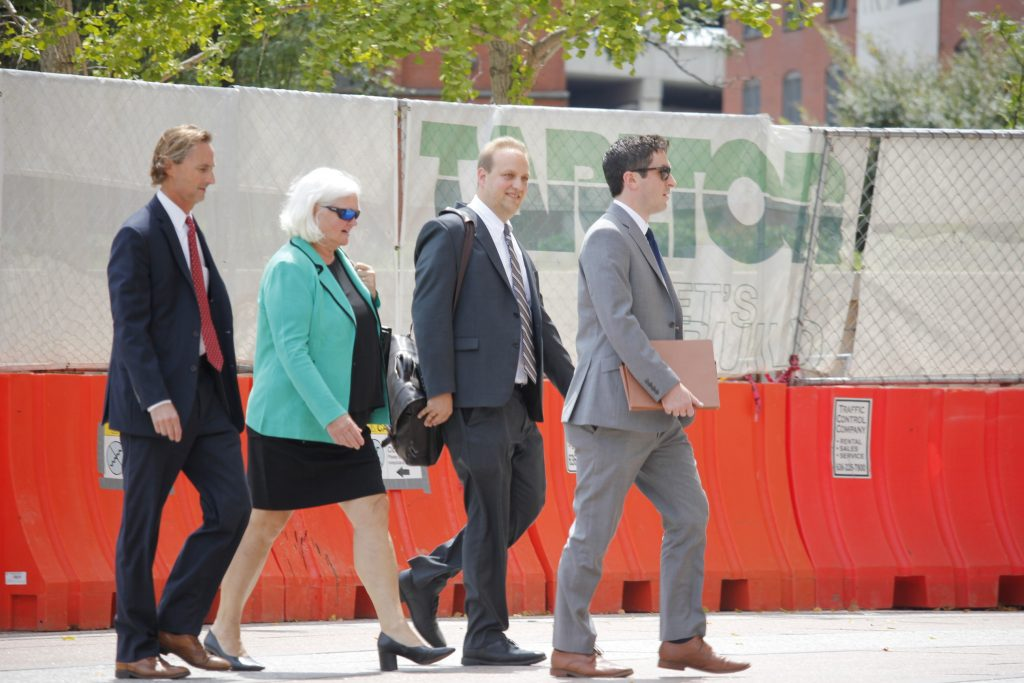 Pictured+above%3A+Former+Economic+Development+Partnership+CEO+Sheila+Sweeney%2C+second+from+left%2C+and+her+team+of+attorneys+leave+the+Thomas+F.+Eagleton+United+States+Courthouse+Friday.+Photo+by+Erin+Achenbach.