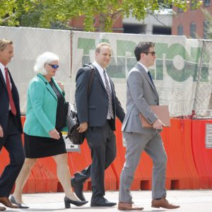 Pictured above: Former Economic Development Partnership CEO Sheila Sweeney, second from left, and her team of attorneys leave the Thomas F. Eagleton United States Courthouse Friday. Photo by Erin Achenbach.