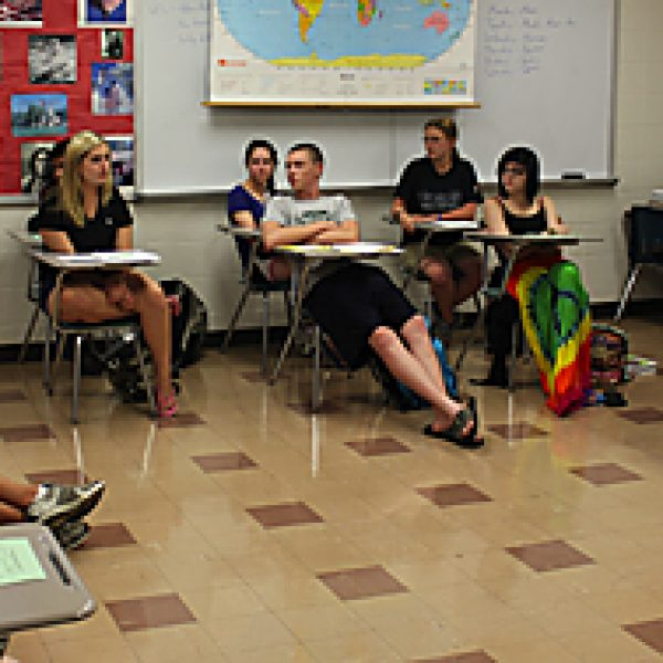 LHS Social Studies teacher and Missouri Teacher of the Year finalist Eric Cochran has a discussion with his students.