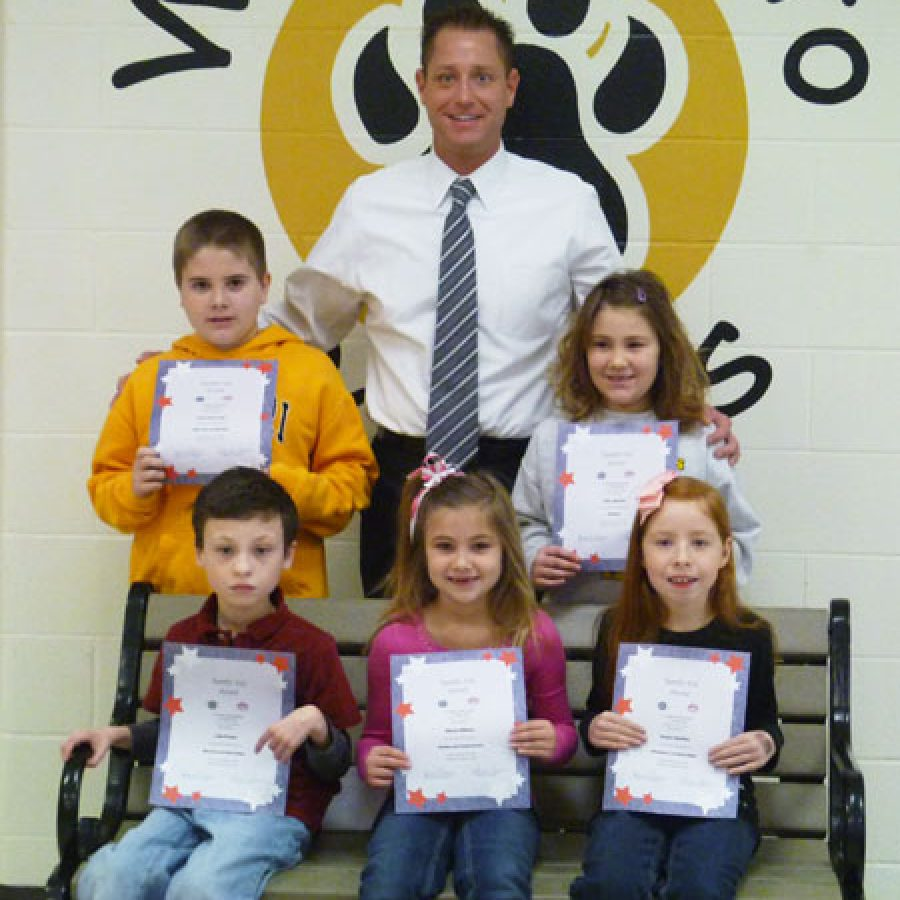 These Rogers Elementary School students recently were named Terrific Kids of the Month by the Kiwanis Club of South County and Ruma's Deli. They were honored for their hard work and great improvement. Pictured, front row, from left, are: Luke Franke, Allyson Williams and Kaylee Hamilton. Back row, from left, are: Aaron Macrander, Principal Jeff Bresler and Chloe Martino.