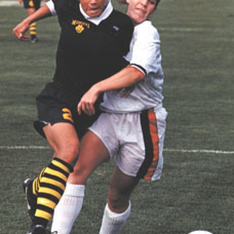 Former Lindbergh High School soccer star Nikki Thole, left, is the most decorated player in University of Missouri soccer history.