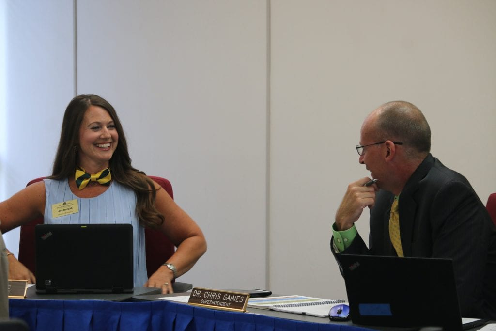 Mehlville+Board+of+Education+member+Tori+Behlke%2C+left%2C+shows+off+the+bow+tie+she+sported+in+honor+of+Superintendent+Chris+Gaines+at+the+July+19%2C+2018+meeting.