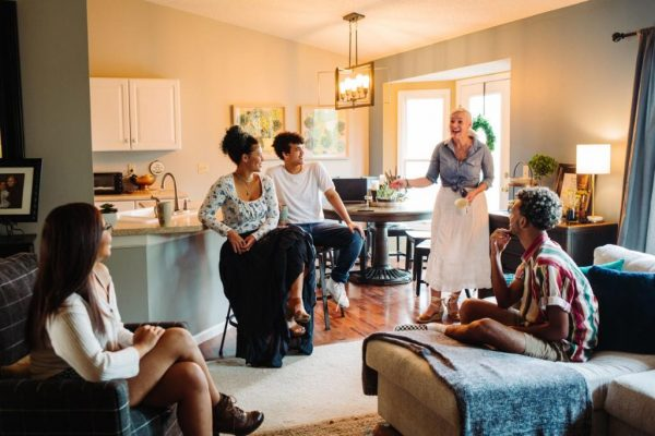 Tracy Verner (far right, standing), talks with her children at their home in St. Louis. They will spend Thanksgiving at home with just immediate family. (photo submitted)