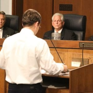 Pictured above: From left, 6th District Councilman Ernie Trakas, R-Oakville, 5th District Councilman Pat Dolan, D-Richmond Heights, and County Executive Steve Stenger listen at the Aug. 1 council meeting to council candidate Michael Burton announce he's no longer running against Dolan. Photo by Jessica Belle Kramer.
