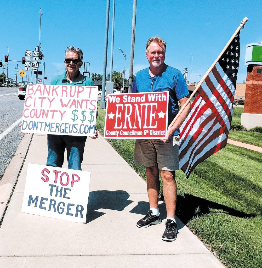 Roughly 20 members of south county Republican groups waved signs in a show of support for 6th District Councilman Ernie Trakas, R-Oakville, at the intersection of South Lindbergh Boulevard and Tesson Ferry Road in 2017. Trakas himself made an appearance at the event with signs against a city-county merger. The councilman is pictured alongside supporter Paul Alvino of Oakville, right. Photo by Gloria Lloyd.