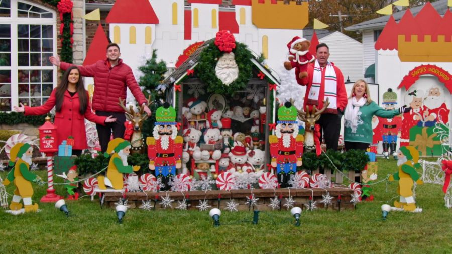Jay and Susan Trevisano, far right, appear with their display and the hosts of 'Great Christmas Light Fight,' filmed in Crestwood last year.