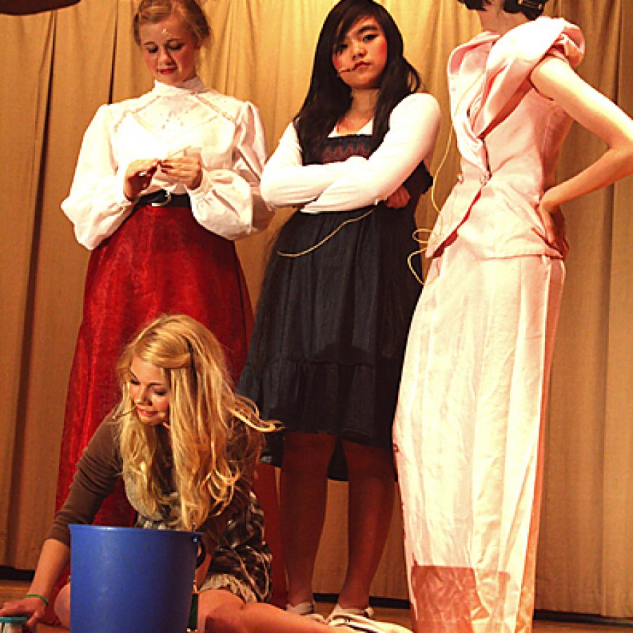 Caley Roberts portrays Cinderella in Green Park Lutheran School's performance of 'Twinderella.' Standing, from left, are: Raechel Reinitz as the cruel stepmother and Marie Nguyen and Gabby Darnell as Cinderella's evil stepsisters, Esmerelda and Ethel.