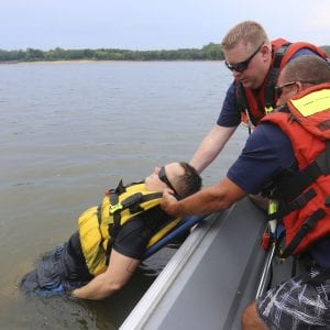 Firefighter-medics David Wideman and Capt. Nick Larosa pull Jared Sarni out of the water during a mock rescue last week. Photo by Jessica Belle Kramer.