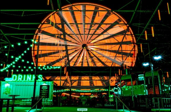 The St. Louis Wheel lit up orange and green for the Union Station Halloween Experience.
