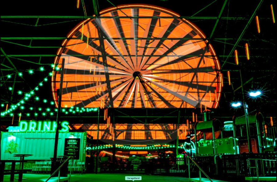 The+St.+Louis+Wheel+lit+up+orange+and+green+for+the+Union+Station+Halloween+Experience.