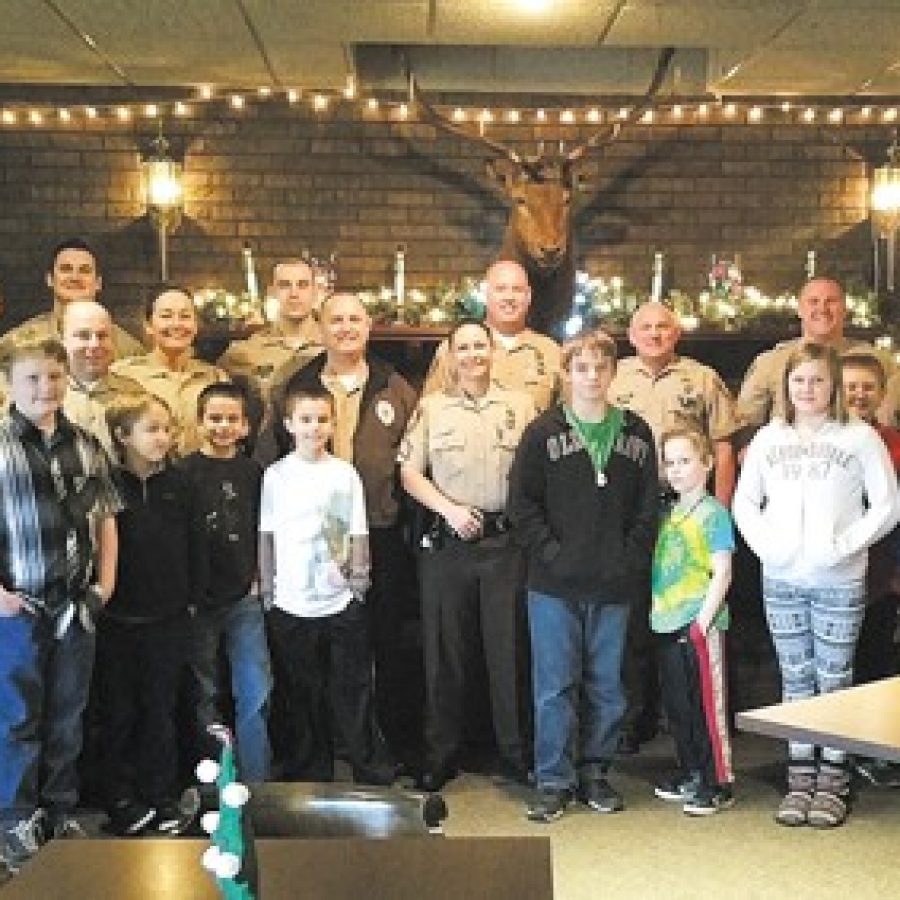 The police officers and children who participated in Crestwood Elks Lodge's \