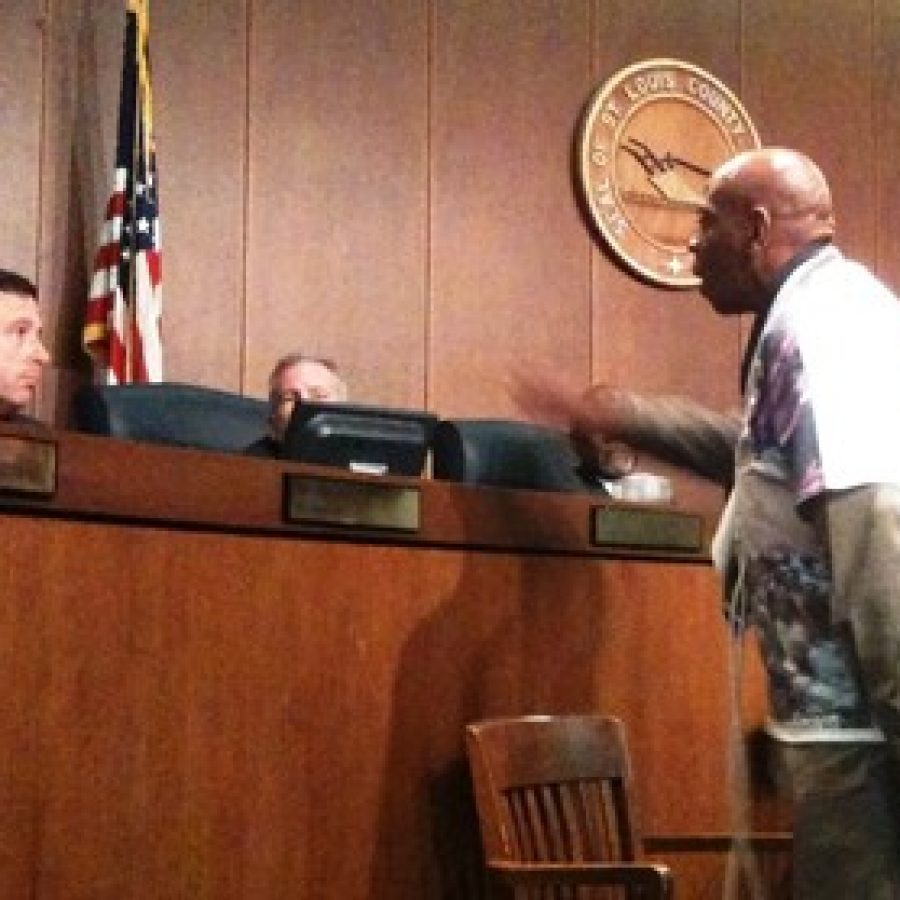 Justice for Mike Brown organizer Anthony Shahid, right, confronts Councilman Steve Stenger during the Sept. 16 County Council meeting.