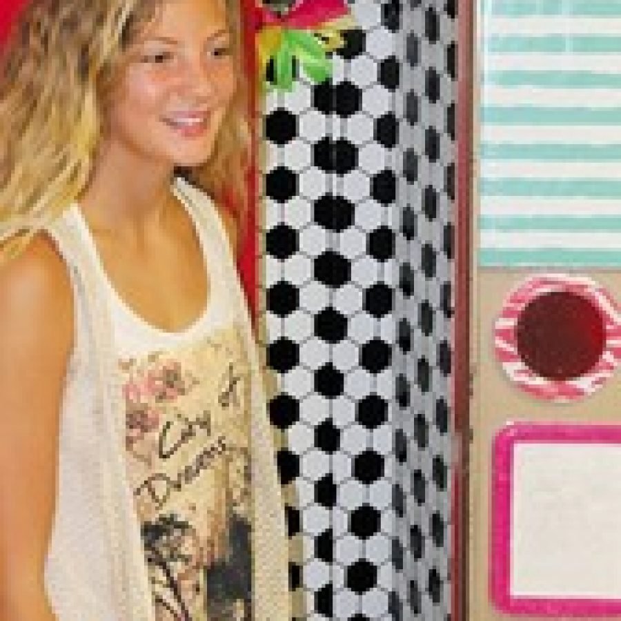 A new school year is underway in the Mehlville School District. Classes began Aug. 14, but students at Oakville Middle School showed up bright and early, one day early, to decorate their lockers. Above, seventh-grader Jordan Beseda is pictured with her decorated locker.