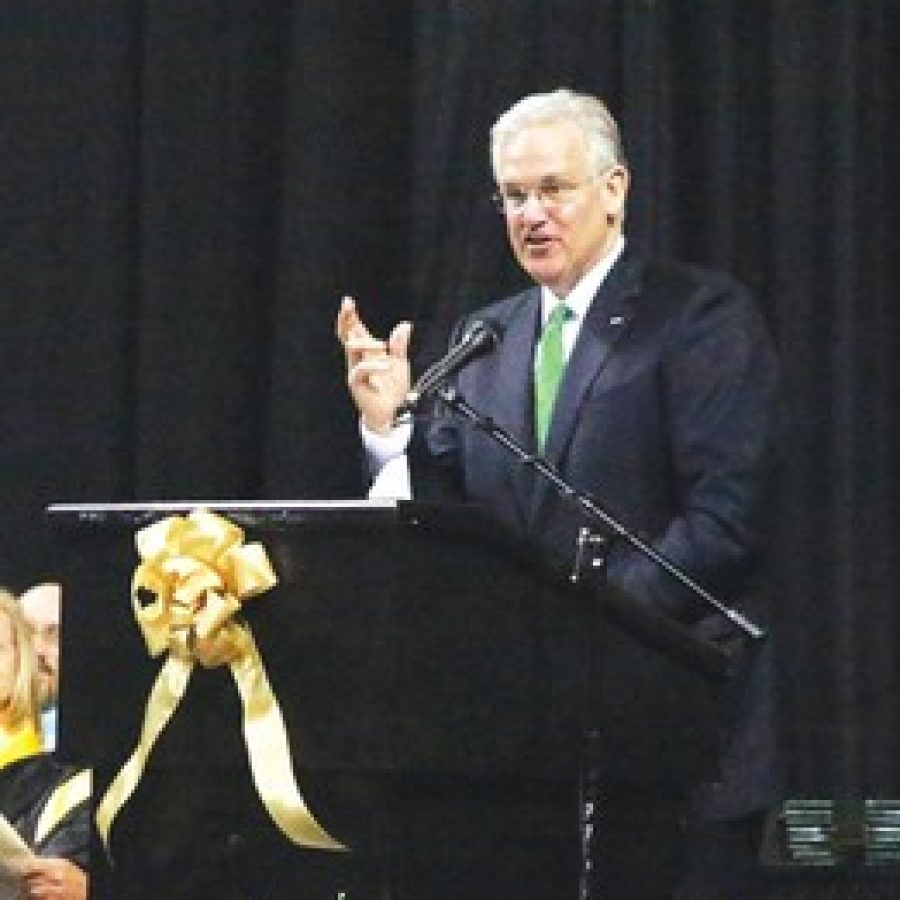 Gov. Jay Nixon congratulates Lindbergh High School graduates on their accomplishments and academic success, but told them in the future they will have to band together with those who dont agree with them to confront the worlds greatest challenges.