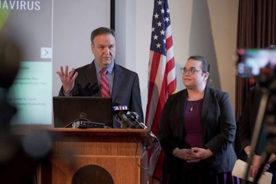 St. Louis County Executive Sam Page updates the public about COVID-19 (coronavirus) preparedness on Friday, Feb. 28, 2020. At right is Spring Schmidt, co-director of the Saint Louis County Department of Public Health.