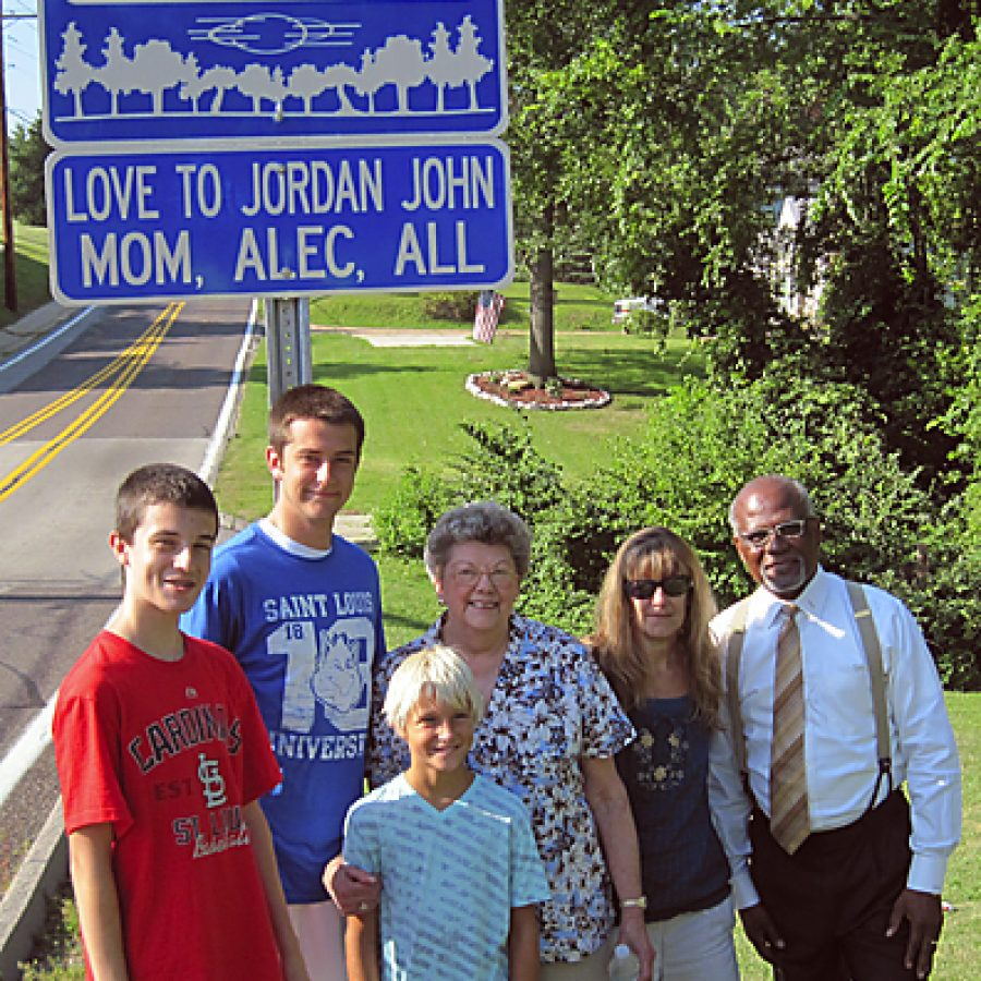 St. Louis County last week unveiled its upgraded Adopt a Roadside program at the intersection of Patterson Road and Marbury Drive in Oakville. County Executive Charlie Dooley was keynote speaker at the event. He was joined by south county resident Susan Berg, who recently adopted a segment of Patterson Road in memory of her son Jordan John Feager. Pictured, from left, are: Garrett Berg; Brett Berg; Alec Boswell, who is Jordan Feagers son; Mary Ann Jarzemkoski, who is Susan Bergs mother and Jordan Feagers grandmother; Susan Berg; and Dooley.