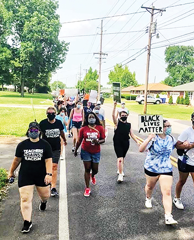 PHOTOS: Teachers hold anti-racism walk for their students