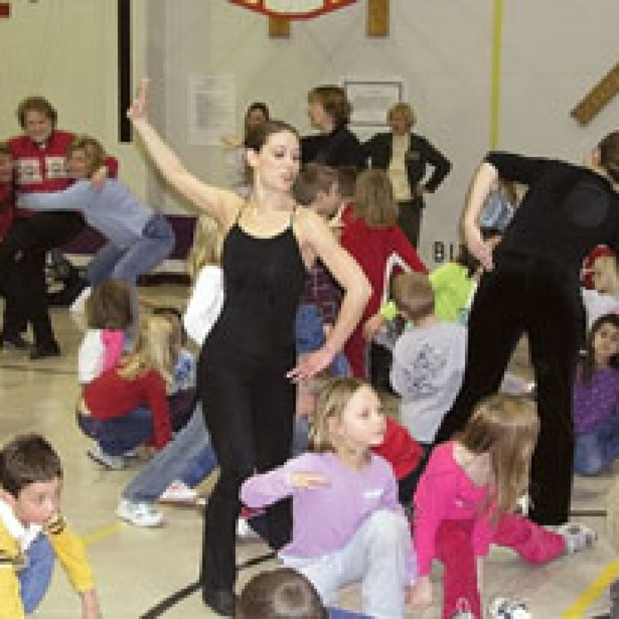 Members of the Mid America Dance Company perform an interactive dance with Hagemann Elementary pupils during the school's recent Fine Arts Fair.
