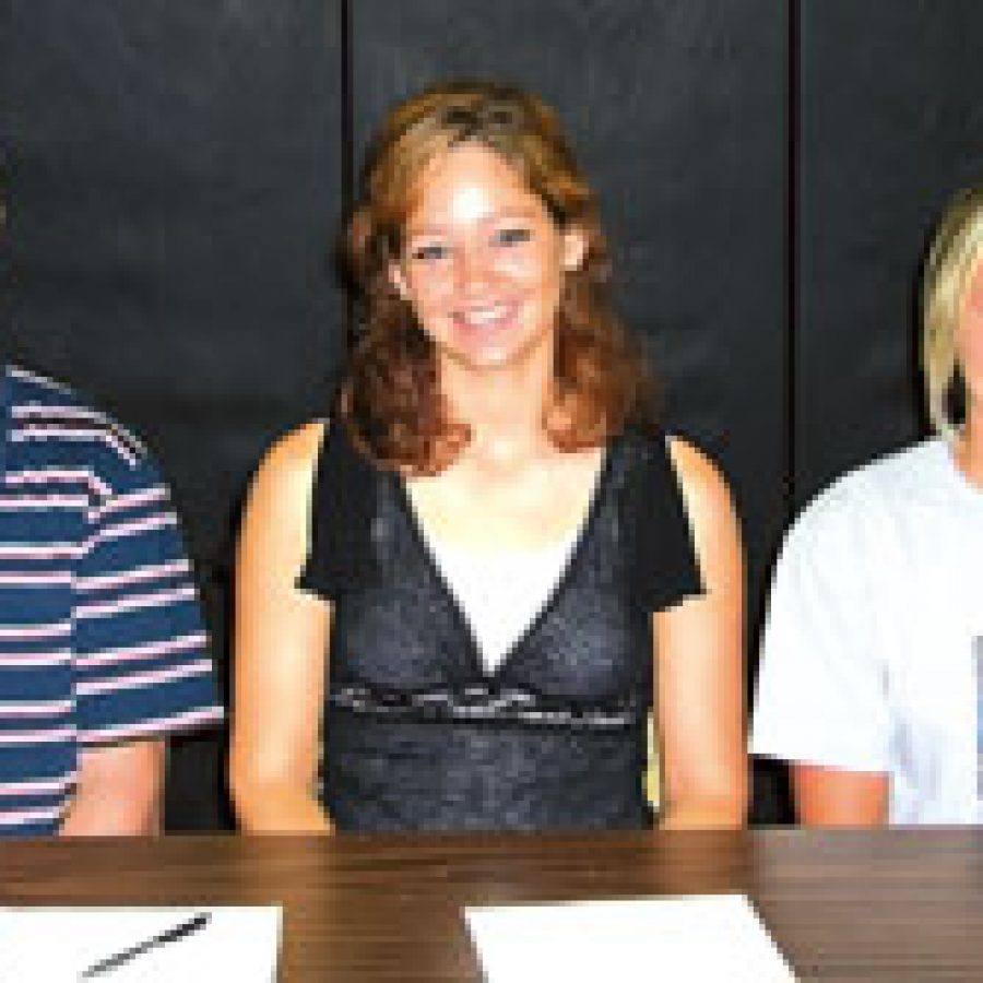 Southwest Missouri State University, Southeastern Louisiana University and Benedictine College in Kansas soon will be new alma maters for these Oakville High athletes. The three graduates recently signed letters of intent to play college sports this fall. From left, are: Brett Williams, Kelly Werner and Amy Fleddermann.
