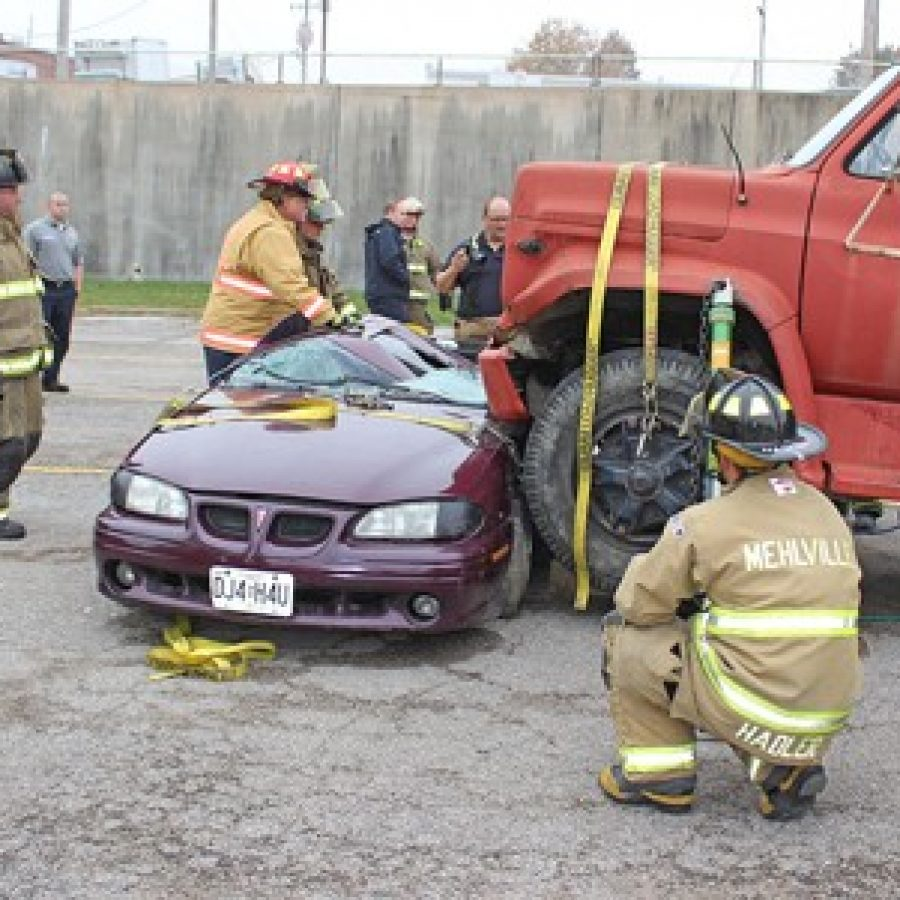 Firefighters participate in Heavy Extrication Class