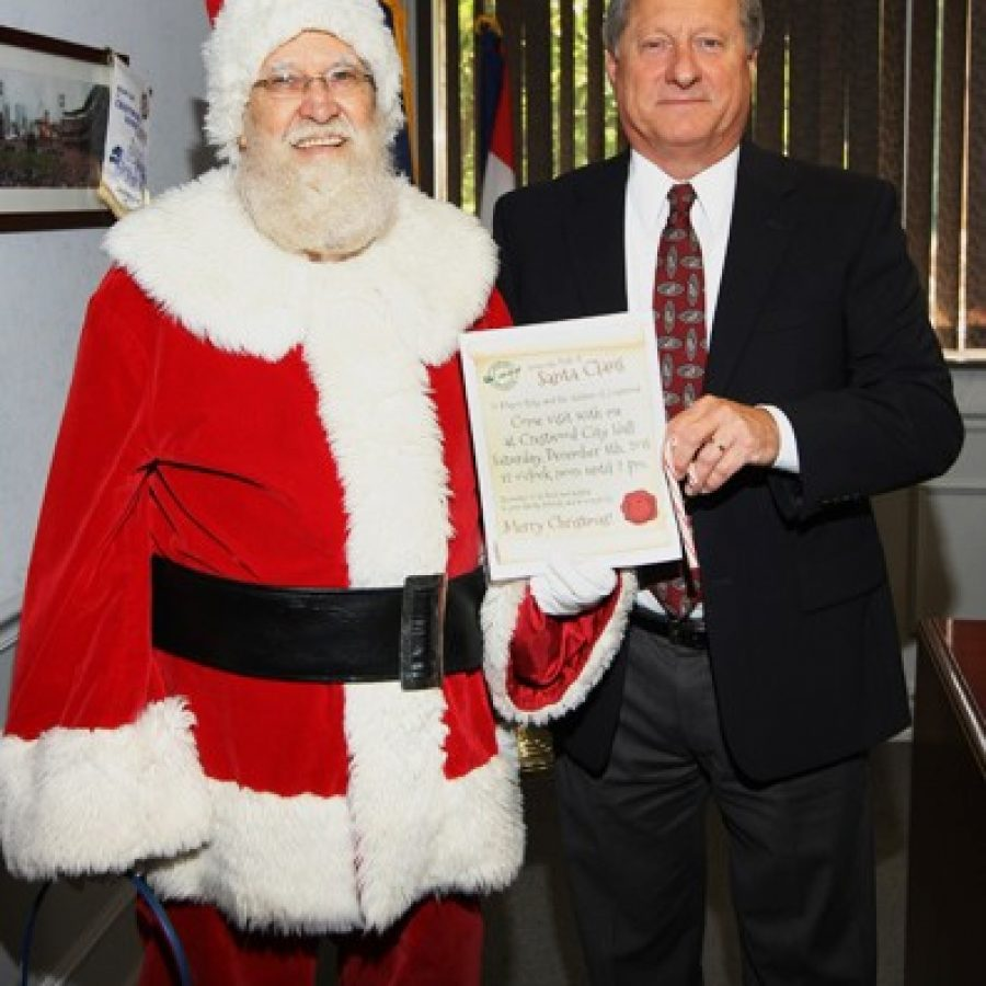 Santa Claus visits Crestwood City Hall and Mayor Gregg Roby in this photograph courtesy of Paul McAllister.