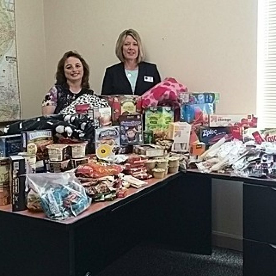 Coldwell Banker Gundaker independent sales associates Angela Hammond, left, and Kelly Barger are shown with an array of 'comforts-of-home' items they collected in the community for Ronald McDonald Family Rooms.