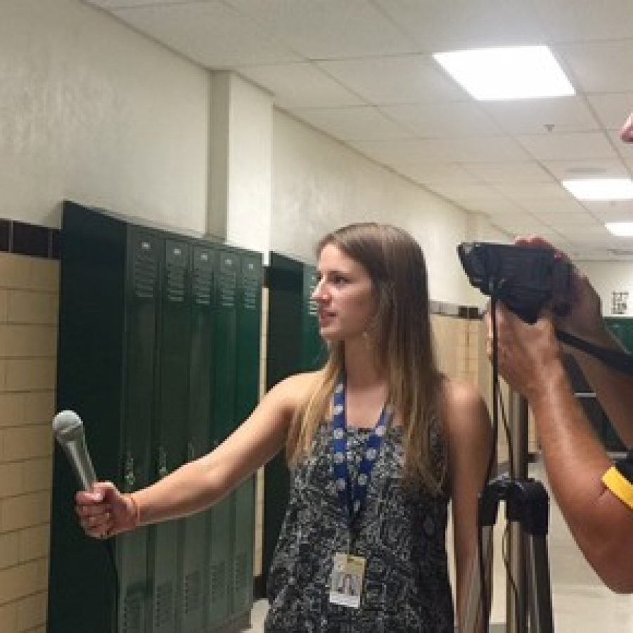 Oakville High School journalism student Hannah Hoffmeister, center, interviews Mark Haefner, left, at Mehlville High School last week after his speech to parents in support of Proposition 