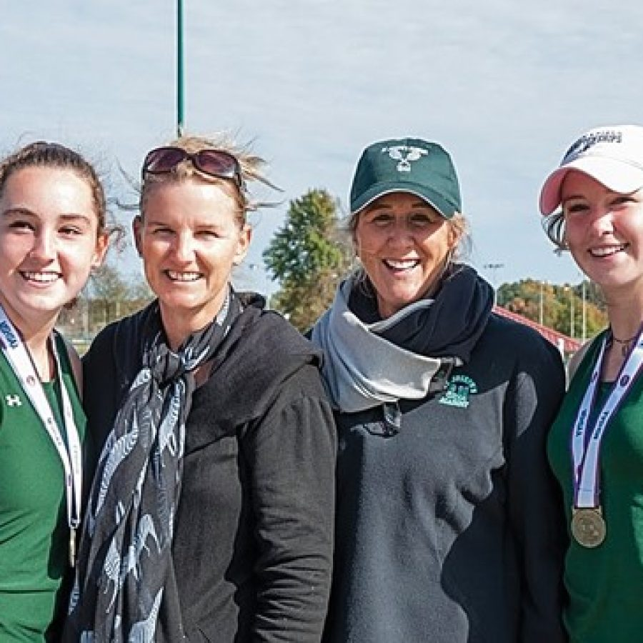 Lindbergh High School sisters Kat, far left, and Alex, far right, Rosenberger celebrate their Class 2 doubles state championship with their mother, Noel Quevreaux, middle left, and Shannon Cook. Quevreaux and Cook teamed up to win Lindbergh's last doubles tennis title in 1984.