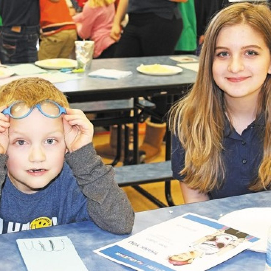 Blades first-grader Blake Givens and Washington Middle School eighth-grader Sabria Bender celebrate the success of Blades' Mathathon for St. Jude.