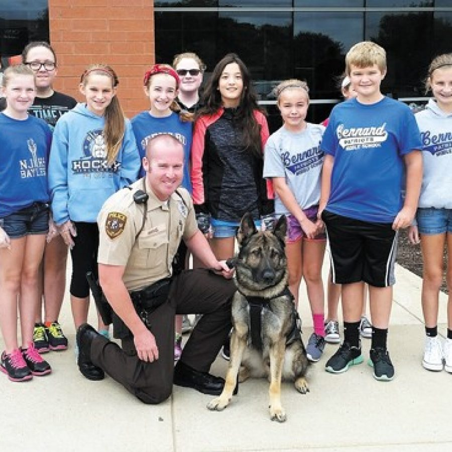 Some of the Bernard students who served first responders lunch last week are pictured with St. Louis County Police Officer Andy Hammel and his K-9 dog, Ivan, who attended the lunch.