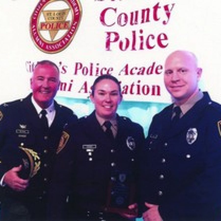 Pictured, from left, are: Police Chief Jon Belmar, Kristina Fosdick and Ben Kloos.