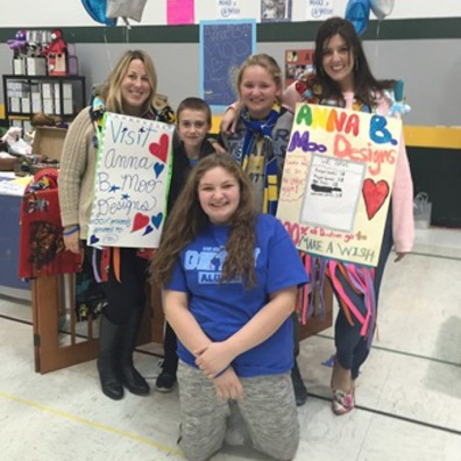Sperreng Middle School sixth-grader Anna Stetzel, front center, blue shirt, sold handmade scarves at the Lindbergh Lacrosse craft fair in October, to help grant a Disney Make-a-Wish for her friend Bella.