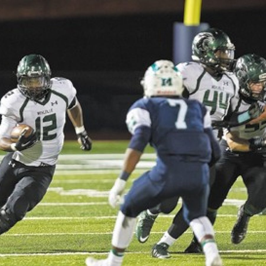 Megan LeFaivre-Zimmerman photoMarquette High School's Xavier Jackson, No. 7, above, pursues Mehlville's Josh Handley, No. 12, in Friday night's game. The Panthers fell 48-0 to the Mustangs to end their 2015 season.