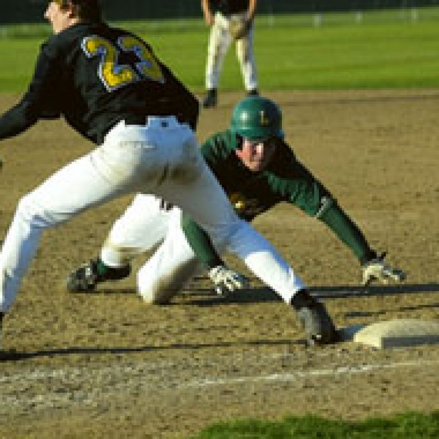 Lindbergh's Scott Hicks 35 dives safely back to first as Lafayette first baseman Chris Hicks waits for the throw from pitcher Bill Allerdissen.Bill Milligan photo