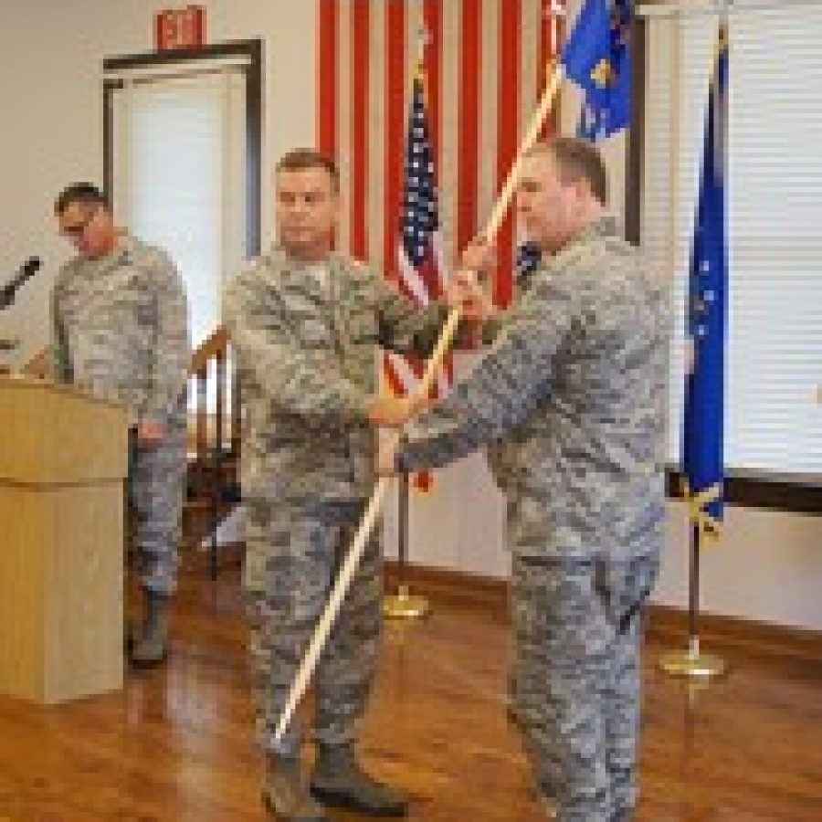 Brig. Gen. David Newman left hands the 157th Air Operations Group flag to Col. Richard Chapman as Chapman assumes command of both the 157th AOG and the Jefferson Barracks National Guard post in south St. Louis County on Saturday. Bill Phelan photo
