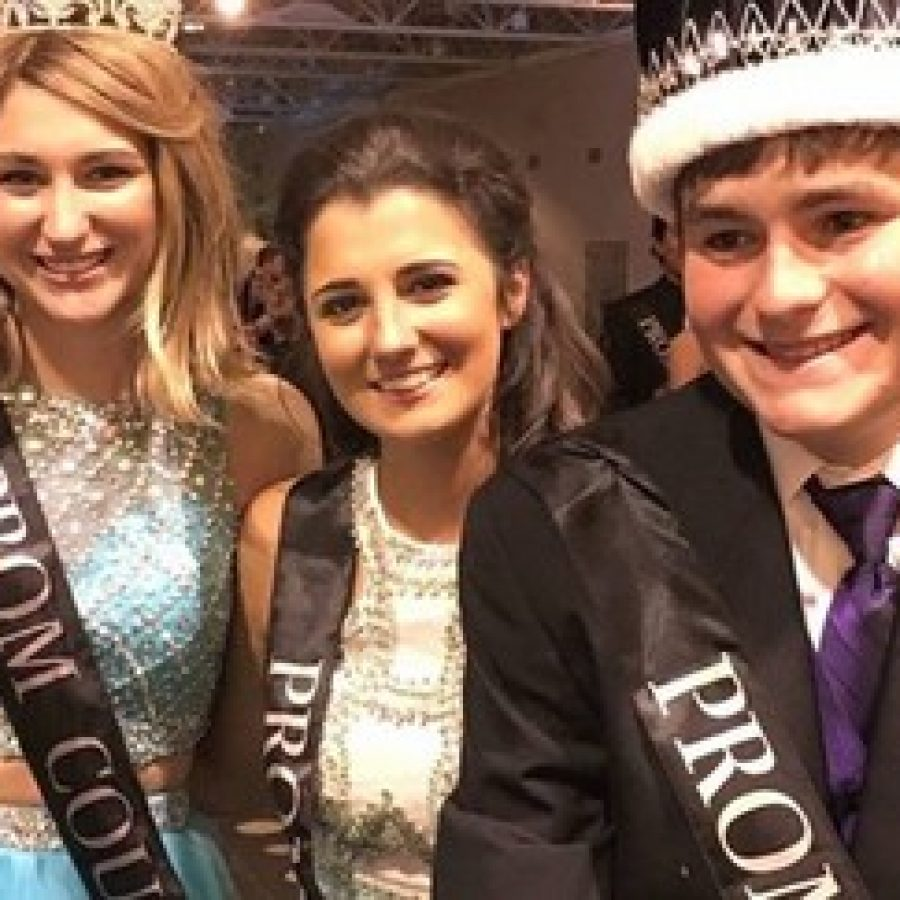 Prom King Matt Schmitt, right, with, from left, Prom Queen Breanna Colombo and Sophie Nelms, a member of the prom court, at Oakville High School's prom.
