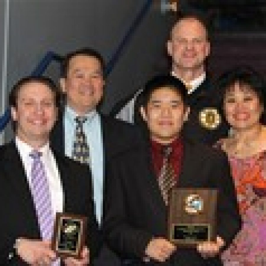 Benjamin Seah was presented the Mid-States Hockey Scholarship and Tigers head coach Derek Stephens was named Coach of the Year during an awards ceremony at the Mid-States Challenge Cup game. Pictured, from left, are: Stephens; Benjamin's father, Francis Seah; Benjamin; and Benjamin's mother; Jenny Seah. In the back row is Mick O'Halloran, Tigers junior varsity development team head coach.