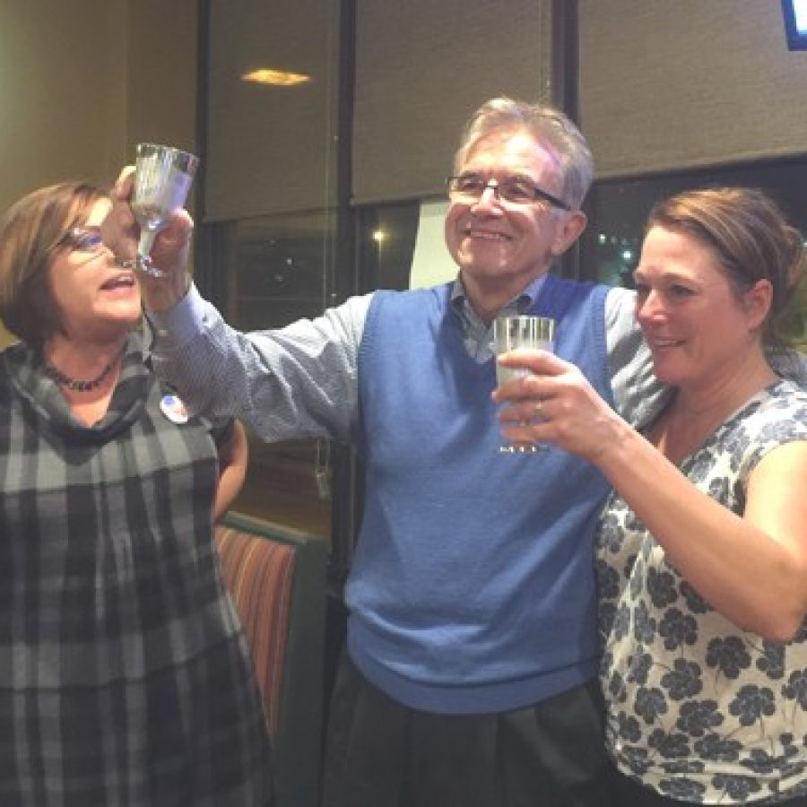 Ernie Trakas, middle, toasts his 6th District County Council win at his victory party at Dulany's Pub with his wife, Lori, right, and south county resident Diane Moss.