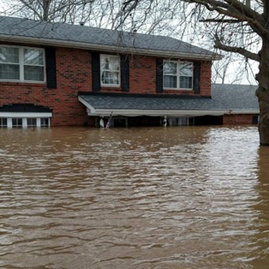 Pictured above, six feet of water cover the main floor and nearly reach the second story of Jennifer and Ryan Daniels' house at 13344 West Watson after last month's historic floods.
