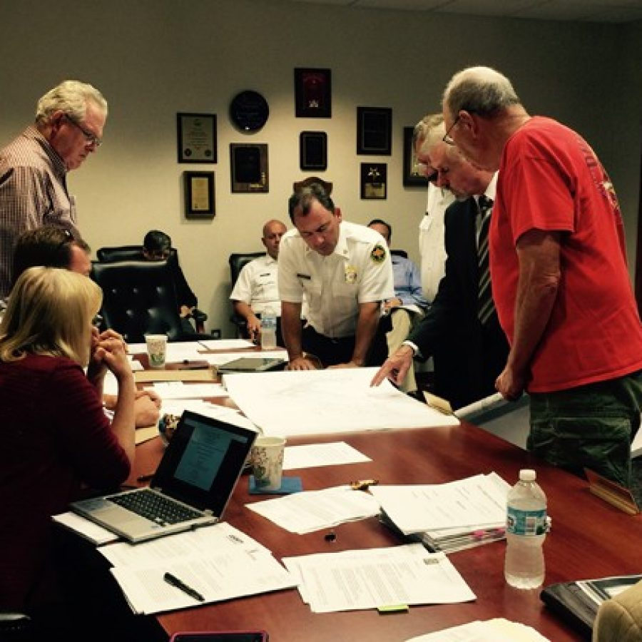 At the Oct. 5 Mehlville Fire Protection District Board of Directors meeting, from left, board Secretary Ed Ryan, Chairman Aaron Hilmer and Treasurer Bonnie Stegman, look at plans for a new apartment complex with, from left, MFPD Chief Brian Hendricks, Fire Marshal Ed Berkel, Mike Falkner of J.H. Berra and resident Bill Kramper.