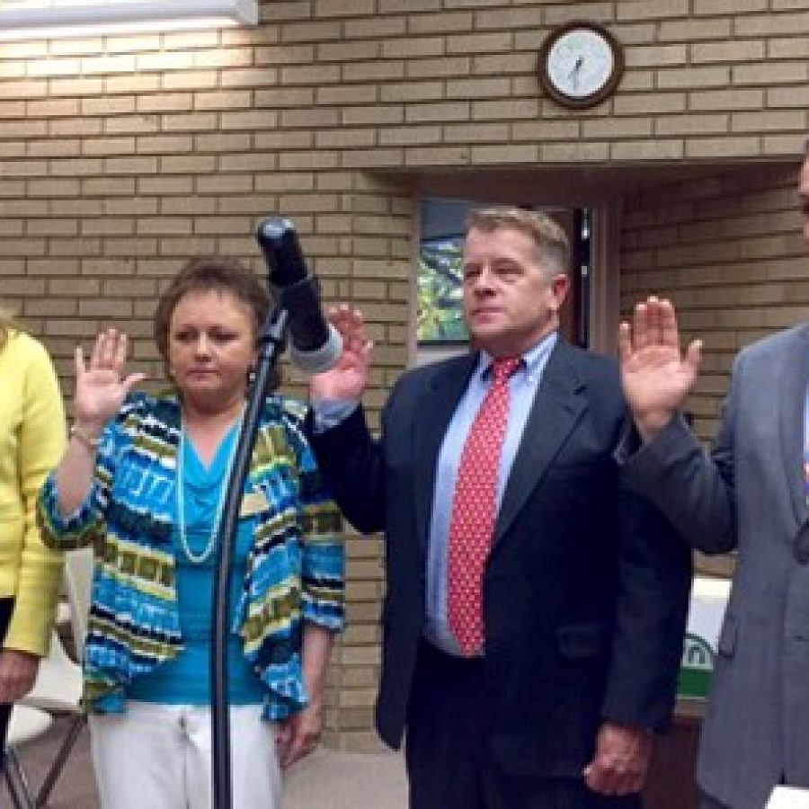 Pictured as they were sworn in by former Deputy City Clerk Carol Lay, far left, last year, are Sunset Hills Aldermen, from left, Pat Fribis of Ward 4, Dee Baebler of Ward 1, Keith Kostial of Ward 3 and Steve Bersche of Ward 2.
