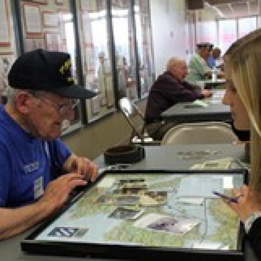 Winfred 'Wimpy' Kenner shares photos and a map of where he served with a Lindbergh High School student during History Alive March 15. Kenner served in the Army from 1943 to 1945.
