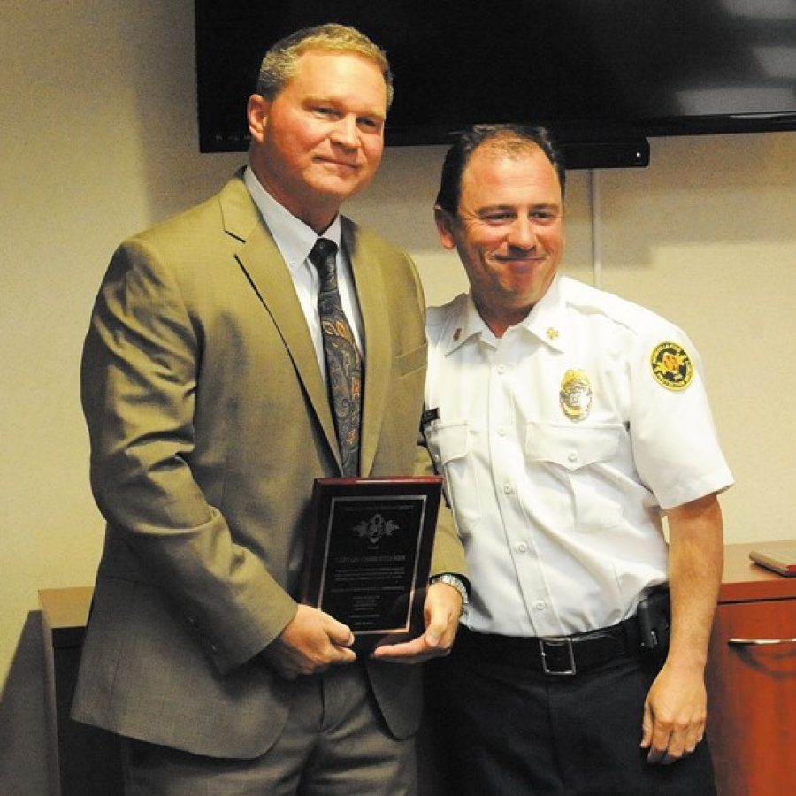 Retired St. Louis County Police Department Capt. Chris Stocker, left, was among those recently honored by the Mehlville Fire Protection District with Making a Difference Awards. Stocker, of Oakville, is pictured with MFPD Chief Brian Hendricks.