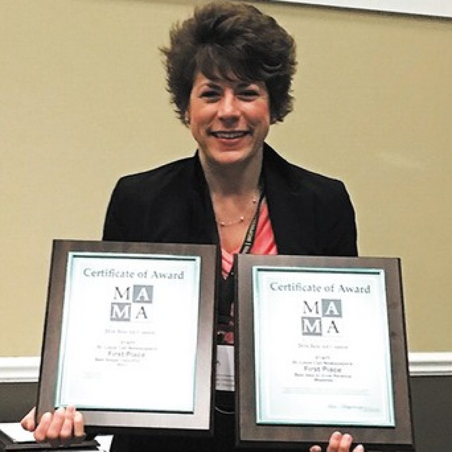 Sales Executive Bea Corbin displays the first-place awards the Call won last week at the Missouri Press Association's Best Ad Contest at Lake of the Ozarks.