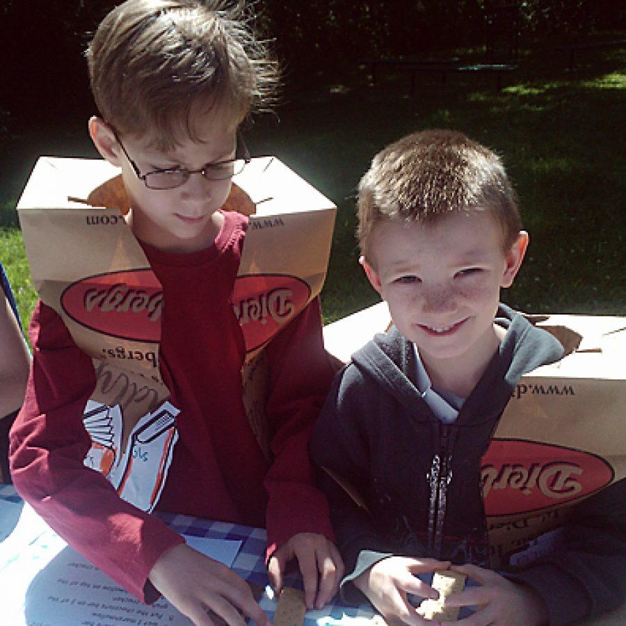 Point Elementary first graders Gus Taylor, left, and Spencer Summers participate in the smores recipe reading activity during Camp Reads-A-Lot, a first grade event held on May 18 to celebrate the students reading accomplishments this year.