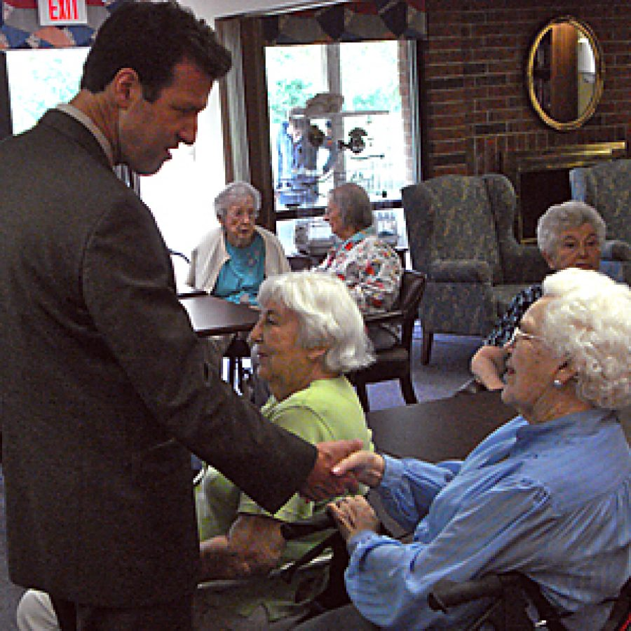U.S. Rep. Russ Carnahan shakes hands with an audience member after speaking last week to nearly 40 residents and guests at the Bethesda Terrace retirement community. Evan Young photo
