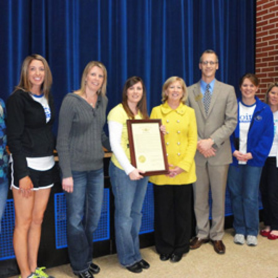 Rep. Marsha Haefner presented a House resolution to members of Point Elementary School's Character Education Committee in recognition of Point being named a Missouri School of Character. Pictured, from left, are: Cathy Navarro, Jamie Stege, Jenn Koenig, April Kedro, Haefner,Mehlville Superintendent Eric Knost, Dara Howard, Tamie Stinson andDee Courtois.