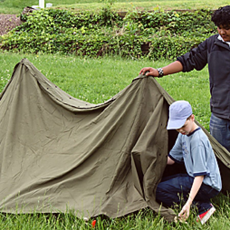 Margaret Buerkle Middle School seventh graders Logan Jacobs, left, and Jose Vasquez pitch a tent during the \